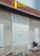 Двери и технические ворота с калиткой и вент. решетками на монолитное здание торгового центра.